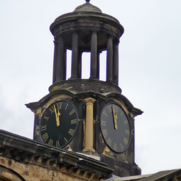 discoloured natural stone on historic clock tower