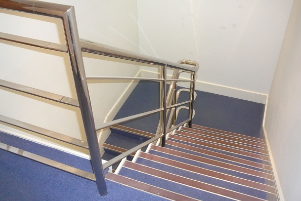 inappropriate steel handrail to staircase