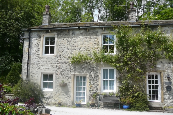 front elevation of detached stone house