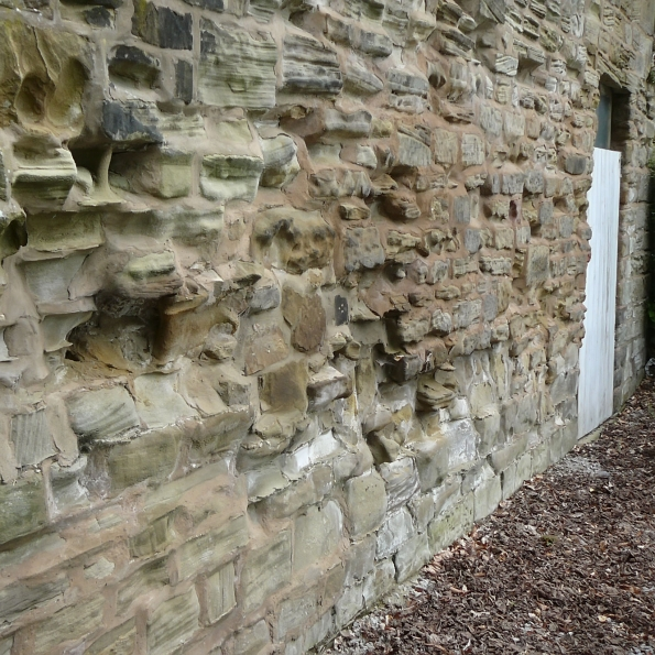 eroded sandstone to external walls