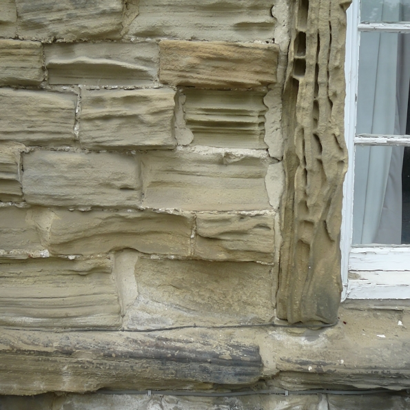 eroded sandstone window jamb