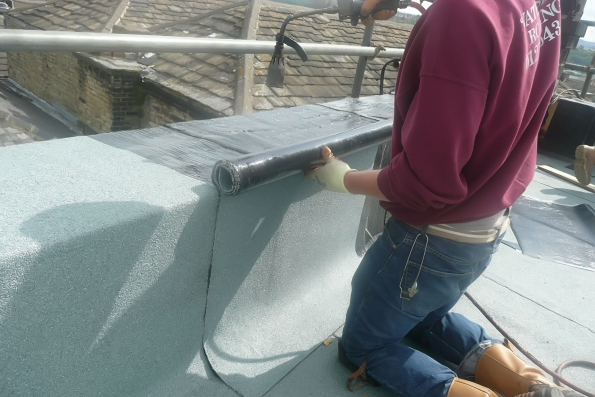 supervision of new roof covering being installed
